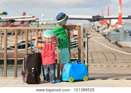 kids looking at seaplanes in Maldives