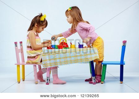 Kids playing with plastic tableware