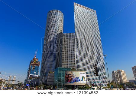Tel Aviv's Hashalom central junction with traffic and the 3 Azrieli buildings