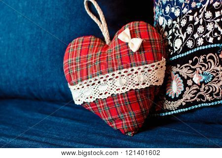 Beautiful Original Red Heart Lies On A Blue Couch