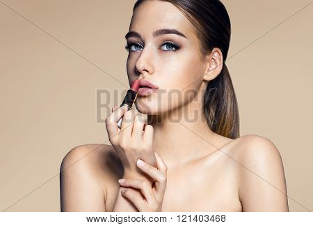 Tempting young woman with lipstick
