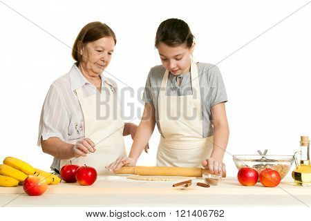 The Grandmother And The Granddaughter Roll Dough