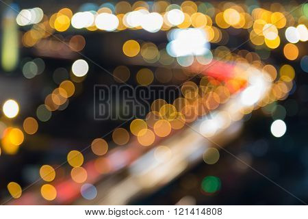 Night blurred bokeh lights highway curved, abstract background
