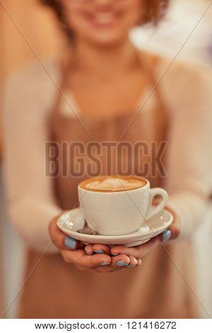 Nice woman holding cup of coffee