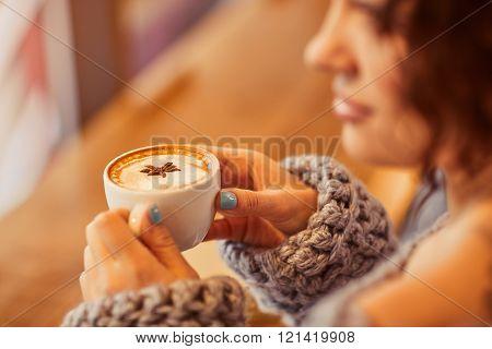 Pleasant woman drinking coffee