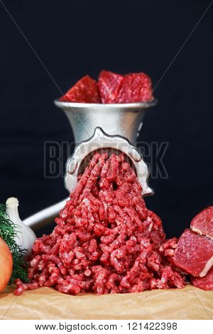 Raw Mincer with fresh minced beef meat