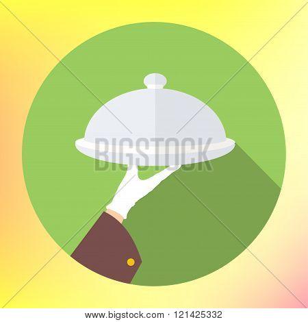 Hand holding silver platter cloche