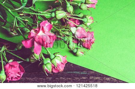 Bouquet Of Pink Roses On A Green Sheet Of Paper