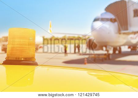 Airplane ready for boarding in airport hub, follow me car