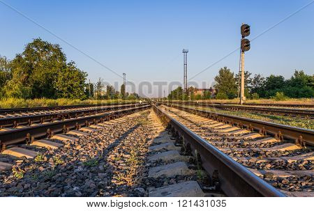 Railway tracks at sunrise.