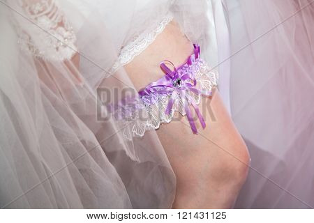 Bride's garter to the young slender leg. Lace wedding garter. Air wedding. Wedding accessory for the bride.  ** Note: Shallow depth of field