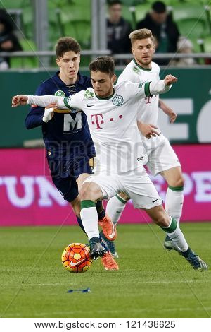 BUDAPEST HUNGARY - MARCH 12 2016: Andras Rado of Ferencvaros (m) dribbles next to Florian Trinks (r) and Roland Sallai of Puskas during Ferencvaros - Puskas Akademia OTP Bank League football match at Groupama Arena.
