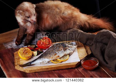 white fish dorado whole with vegetables corn tomato lemon pepper on the board mink animal stuffed taxidermy idea unusual creative
