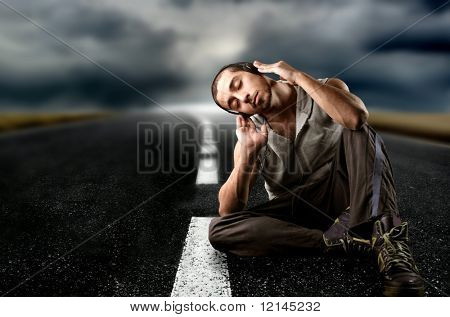 a boy on the street listen the music