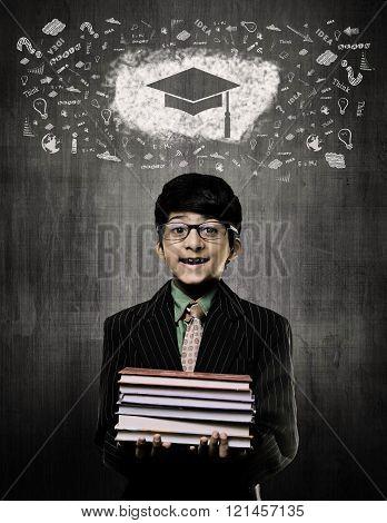 Graduation Cap. Genius Boy Holding Books Wearing Glasses,  Chalkboard