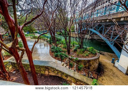 Scenic Views of the Wandering Sidewalks and Arched Bridges of the Riverwalk on a Rainy Day at San Antonio, Texas.