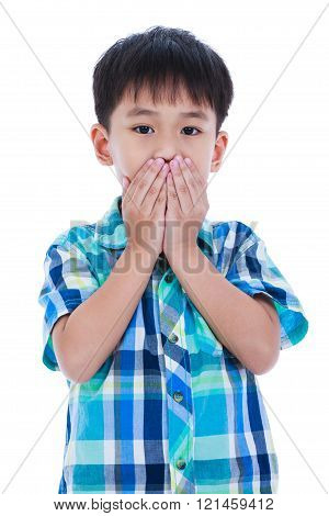 Asian boy covering his mouth. Isolated on white background.