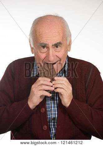 old man eating chocolate