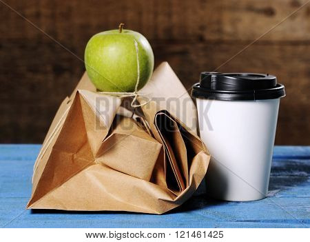 healthy business lunch with paper bag