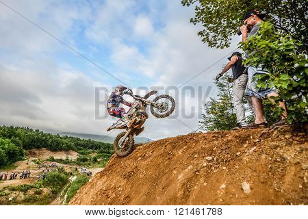 Yuzhno-Sakhalinsk Russia - August 14 2015: the struggle of motorcyclists on Enduro competitions hard Enduro no place to run