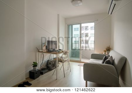 Living Room With Working Area In Apartment