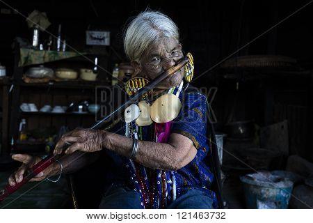 Chin tribe tattooed faced woman (Daai)