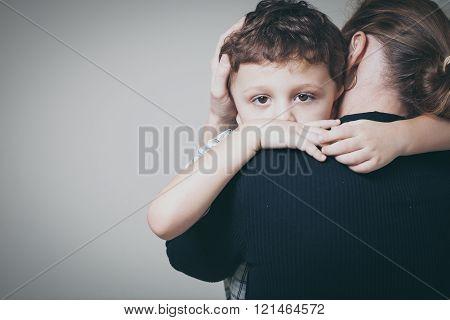 Sad Son Hugging His mom
