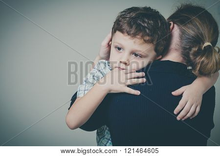 Sad Son Hugging His Mother
