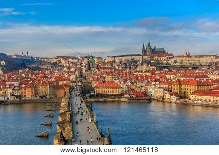 Prague, Czech Republic - January 16 2015: View onto Prague Castle from Charles Bridge (a.k.a. Stone Bridge Kamenny most Prague Bridge Prazhski most) over Vltava river in Prague Czech Republic after sunset
