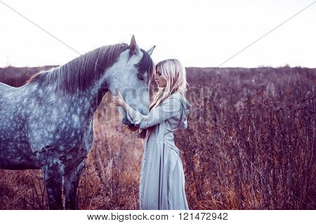 Portrait of a beauty blondie with horse ** Note: Visible grain at 100%, best at smaller sizes