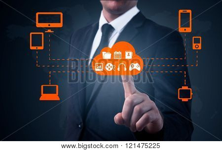 Businessman touching a cloud connected to many objects on a virtual screen, concept about internet o
