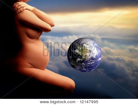 a closeup of a pregnant woman and a globe