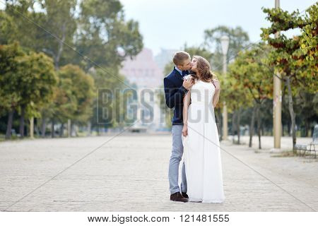 Happy Couple Bride And Groom Tenderly Embraced In Wedding Day  In Napoli, Italy