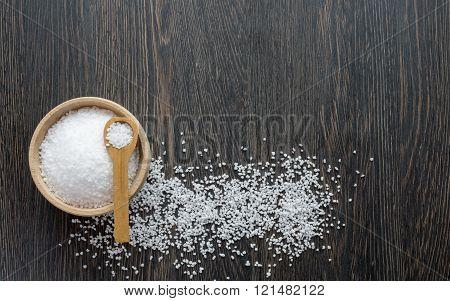 A wooden bowl of salt crystals