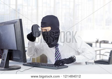 Hacker Looking For Information In Office