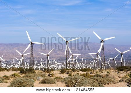 Renewable energy windmills line the mountaintops of Palm Spring