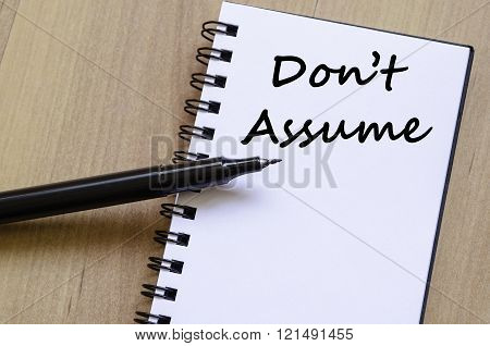 Don't assume text concept write on notebook with pen