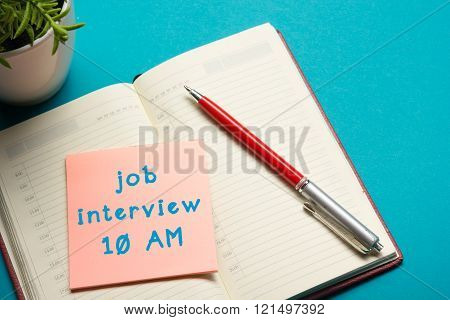 Job interview concept . Office table top view. Notepad, pen and reminder with word. poster