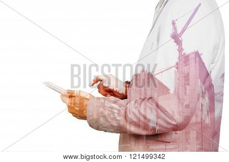 Double Exposure Of Business Man Use Digital Tablet With Construction Site And Power Crane