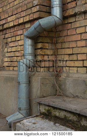 Vintage brick wall texture and broken drainpipe