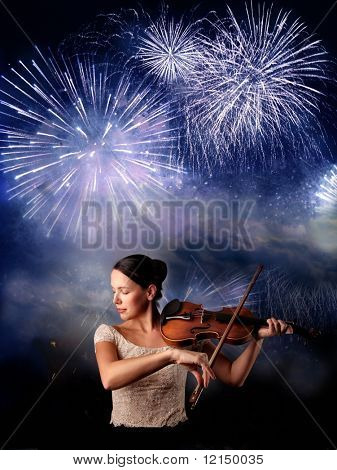 woman with violin and fireworks