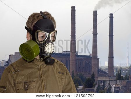 Man In Gas Mask Against The Backdrop Of Industrial Landscape