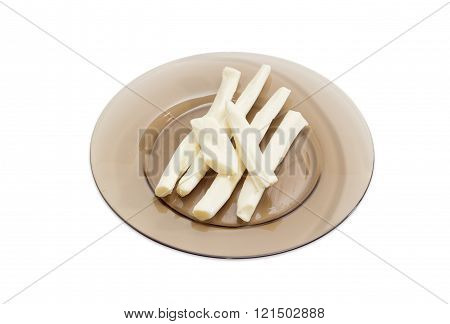 Sticks Of A Chechil Cheese On A Glass Dish