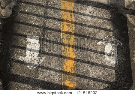 shadow line on two direction arrow sign on grunge floor