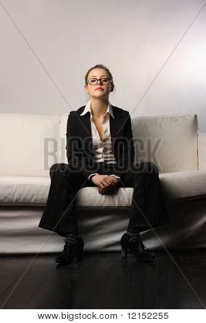 businesswoman sitting on a sofa poster