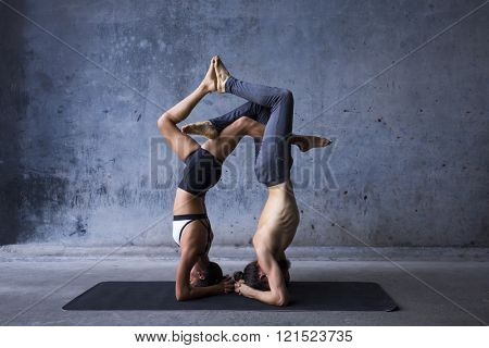 Couple practicing acroyoga together