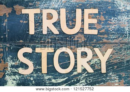 True story written with wooden letters on rustic surface
