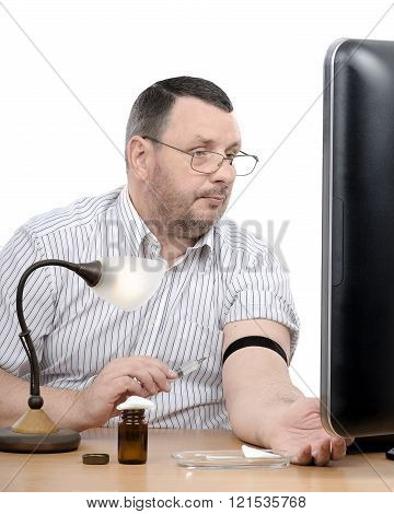 Middle-aged Man Learns How To Give An Intravenous Injection