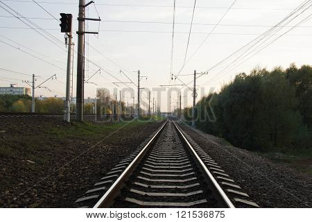 Railroad Tracks In The Evening In City