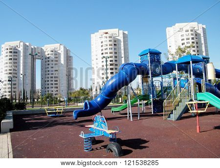 Playground near modern white buildings in quarter Neve Rabin in Or Yehuda Israel